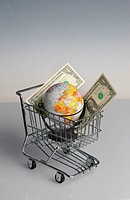 symbol globe in a shopping cart, symbol global buying