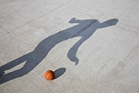 Shadow playing basketball