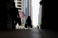 Rear view of pedestrians in an arcade, Philadelphia, PA, USA
