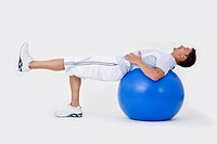 A man stretching with an exercise ball