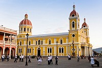 School children playing in the Parque Central in front of the Cathedral of Granada, Nicaragua