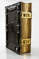 Antique book with hard ornamental leather cover and shiny brass clasps