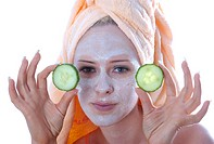 Young woman has applied a facial mask