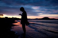 Silhouette of a woman at sunset in the beach