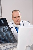 Doctor looking at an x-ray result