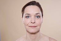 Woman´s face with marks for a cosmetic surgery