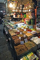 A shop with small piles of colorful spices and grains in the main souq of Damascus with price tags on the top, Syria, Near East, Asia