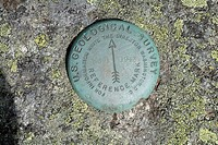 Us Geological Survey Marker on the summit of Mount Isolation during the summer months in the scenic landscape of the White Mountains, New Hampshire US...