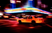 New york city yellow taxi cab passing the Radio City Music Hall in Manhattan, Sixth Avenue  New York NY New York State, United States of America USA
