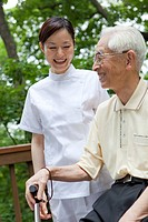 Japan, Tokyo Prefecture, Senior man with female nurse, smiling, close_up