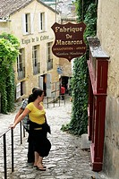 Street scene couple Macaron shop Bordeaux vineyard town St Emilion France