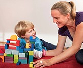 mother and son play with building blocks