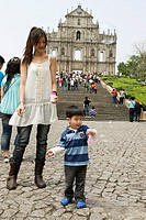child playing with soap bubles in front of ruins of Saint Paul´s Cathedral,Macau,Special Administrative Region,China,Asia