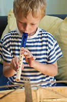 Little boy playing recorder