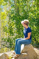 Girl looking at Aspen trees, Colorado, USA