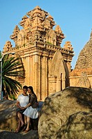 Asia, Vietnam, Nha Trang  Po Nagar Cham Towers  A young vietnamese couple posing for a photograph  The Cham Towers dating back to the 7-12 century are...