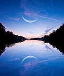 Moon and surreal reflection in lake, Whitnall Park, Wisconsin