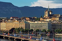 Mont Blanc bridge with the spire of St  Pierre Cathedral at the background  Geneva, Switzerland