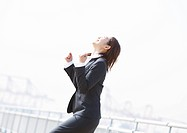Businesswoman with her fist in the air