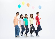 Young men and women holding balloons