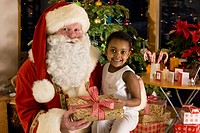 Santa and girl holding Christmas gift