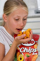 Girl eating potato chips