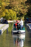 Man steering narrow boat in canal