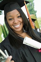 Graduate with Diploma outside portrait