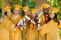 Group of graduates holding diplomas outside portrait