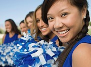 Cheerleaders sitting on bench portrait