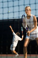 Tennis Player standing holding racket near net Waiting For doubles partner to Serve low angle view
