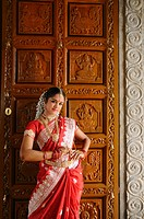 Indian lady in traditional costume standing at temple´s door, Penang, Malaysia