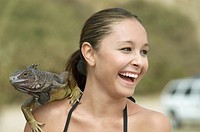 Laughing Woman with Iguana on Her Shoulder close_up