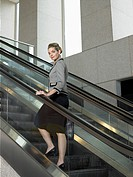 Businesswoman on escalator portrait
