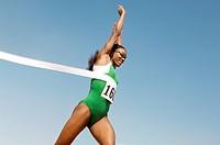 Female runner winning race side view