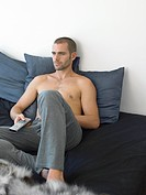 Man watching TV on sofa