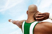 Shot Putter holding shot put head and shoulders back view