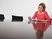 Businesswoman reading in conference room