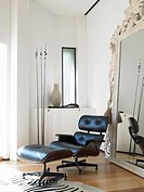 Modern room with leather chair and big mirror