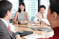Business people sitting round table in conference room (thumbnail)