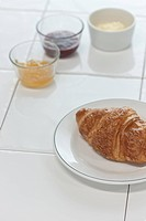 croissant with apple and strawberry jelly