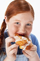 Overweight girl 13_15 Eating pastry portrait close_up