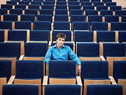 Businessman sitting alone in Auditorium portrait