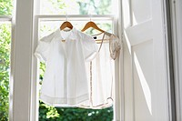 Two blouses on Hangers in domestic window
