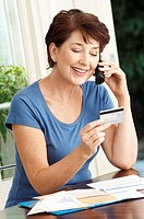 Woman paying credit card using cell phone