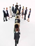Group of Businesspeople walking in arrow formation (thumbnail)