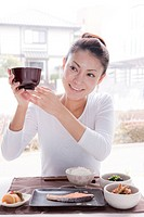 Young Woman Holding Miso Soup Bowl
