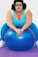 Overweight Woman sitting on Exercise Ball portrait (thumbnail)