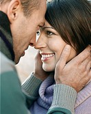 Couple looking in each others eyes outdoors close up (thumbnail)