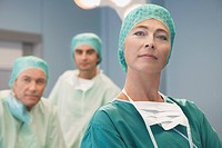 Head of Surgical Team with surgeons in operating theatre portrait